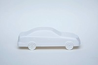 A white miniature model car on a white background