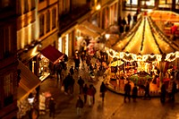 Tilt_shift of a crowd of people at a carousel at an outdoor festival, Strasbourg, France