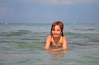 little girl swimming in the sea