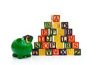 A stack to color wooden blocks of the alphabet isolated over white, Schools Costs