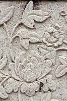 Stucco art flower art faces in the Temple of Dawn.