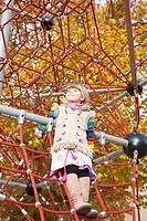 Girl standing on jungle gym