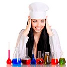 Young scientist at the table with test tubes on white background