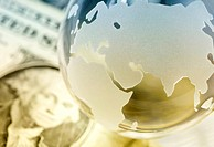 Globe and american dollars. Global finances concept