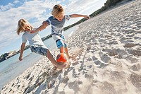 Spain, Mallorca, Children playing soccer on beach
