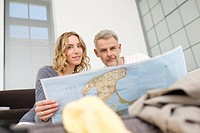 Germany, Leipzig, Couple with map, portrait