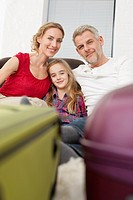 Germany, Leipzig, Family ready for vacation, smiling, portrait