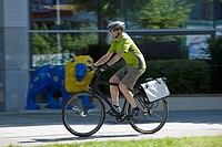 Germany, Bavaria, Munich, Mature man riding bicycle