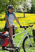 Germany, Bavaria, Mid adult woman with bicycle, smiling