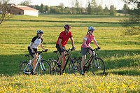 Germany, Bavaria, Man and women riding bicycle