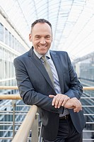 Germany, Leipzig, Businessman smiling, portrait