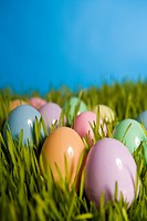 Group of colored Easter eggs in grass