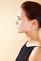 Young woman in black dress, close up