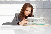Germany, Leipzig, Businesswoman looking at architectural model