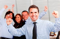 Happy man with arms up leading a successful business group