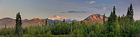 Sunrise alpenglow lights up Mount McKinley and the Moose's Tooth, as seen from the Veterans Memorial in Denali State Park, Alaska, Summer