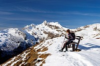Hiker resting while ascending Penser Weissenhorn Mountain above Penser Joch Pass, looking towards the summit of Penser Weissenhorn Mountain, Sarn Vall...