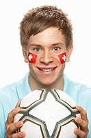 Young Male Football Fan With Swiss Flag Painted On Face