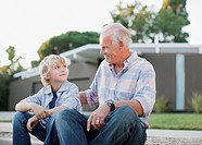 Older man and grandson sitting together