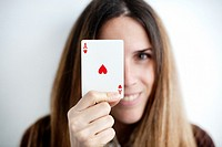 Woman holding ace