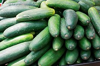 cucumbers bunched together for sale at market good as a background