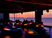Time lapse view of bumper cars at sunset