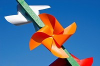 colourful paper windmills on sky background