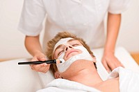 Male cosmetics _ facial mask in luxury spa center