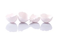 Group of eggshells with reflection on white background