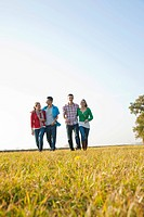 Young people on a walk outdoors, in nature