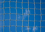 Soccer goal net with a sky background
