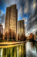 Surreal HDR of Berlin city, shot early evening, Communist flats reflecting in the canal in Mitte