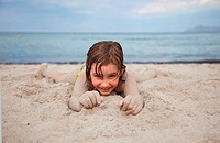 little girl on sandy beach