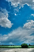 Summer weather conditions with blue sky and dramatic clouds in Suffolk, England