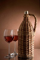 Bottle with red wine and two glasses