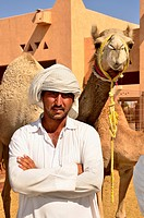 Camel vendor at the camel market of Al Ain, Abu Dhabi, United Arab Emirates, Arabian Peninsula, Asia