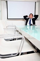 Businessman daydreaming in conference room