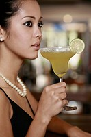 Woman with a glass of cocktail
