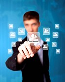 Man pressing social network icon, futuristic technology