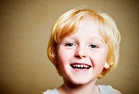 Five-year-old boy, smiling, portrait