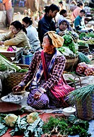 Smiling woman selling vegetables at a market in Myanmar, Burma, Southeast Asia, Asia
