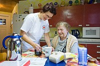 Ambulatory care of the German Red Cross, nurse Anke Lehmann preparing breakfast for a heart attack patient, Treuenbrietzen, Brandenburg, Germany, Euro...
