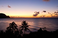 Napali Coast glowing at sunset Prince Ville..