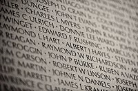 Black and white image, sepia, Vietnam Veterans' Memorial Wall, National Memorial with the names of fallen U.S. soldiers in the Vietnam Warn, Washingto...