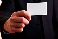 Hand holding an empty white business card