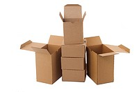 Brown cardboard boxes arranged in stack on white background