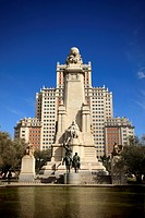 A picture of Don Quixote monument in Madrid, Spain over blue sky