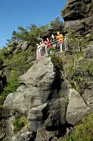 Hikers at viewpoint on Felsengasse rock formation, Zittau Mountains, Saxony, Germany, Europe