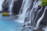 Detail of Waterfall Hraunfossar.Detail of a waterfall formed by a lava flow in Hraunfossar, Hraunfossar, Borgarfjordur, Iceland