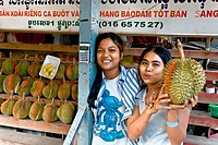 Sales girls holding a durian fruit, Phnom Penh, Cambodia, Southeast Asia, Asia